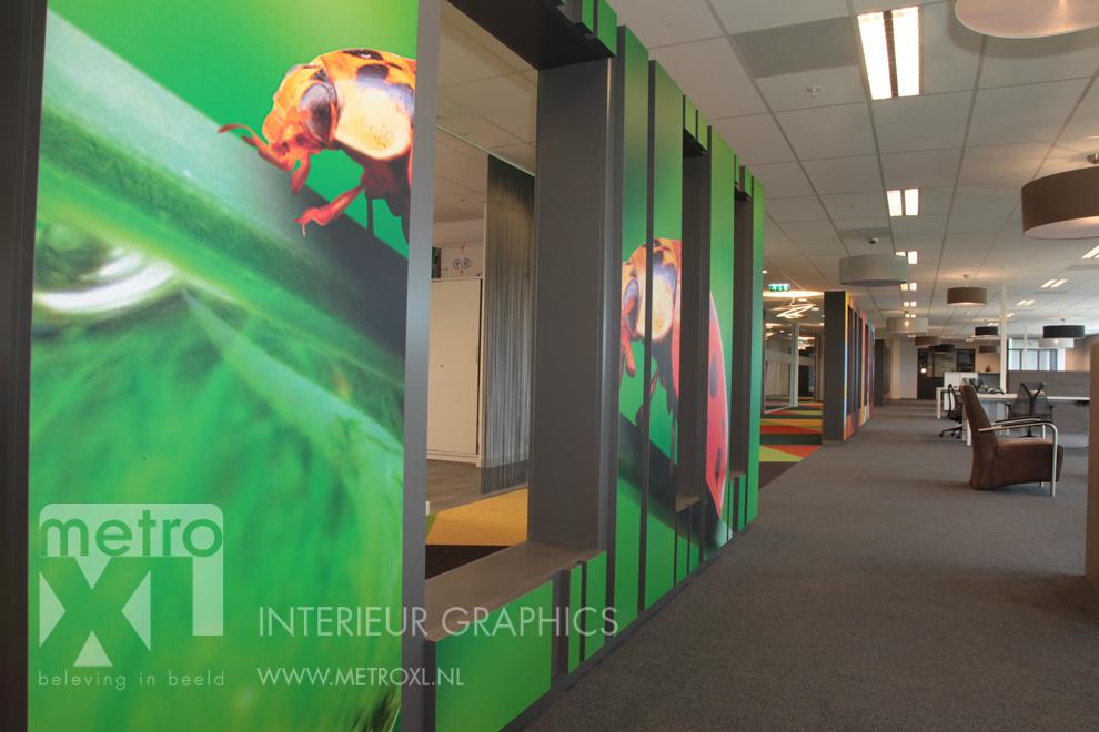 Wandbestickering kantoor interieur natuur lieveheersbeestje